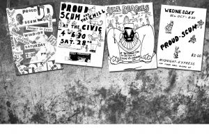 Picture of proud scum posters on a grungy wall
